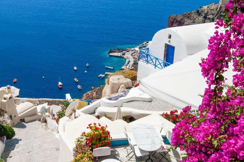 santorini-white-houses-flowers-classic-view-greece-europe-cel-tours